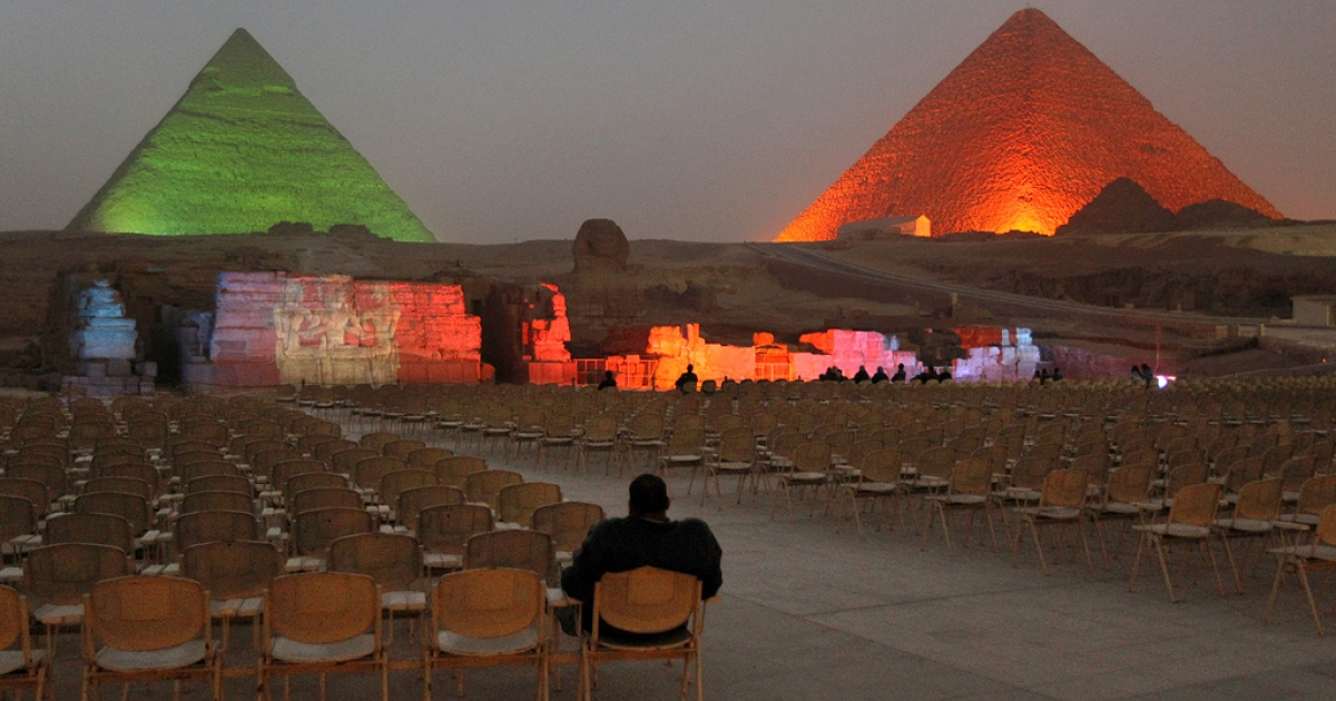 An Egyptian visitor watches a nearly empty light and sound show at the Giza pyramids on February 15, 2011 in Giza, Egypt. With tourism counting for 6 percent of Egypt's gross domestic product, the country's economy has taken a huge hit after foreign tourists fled during Egypt's uprising.</p>