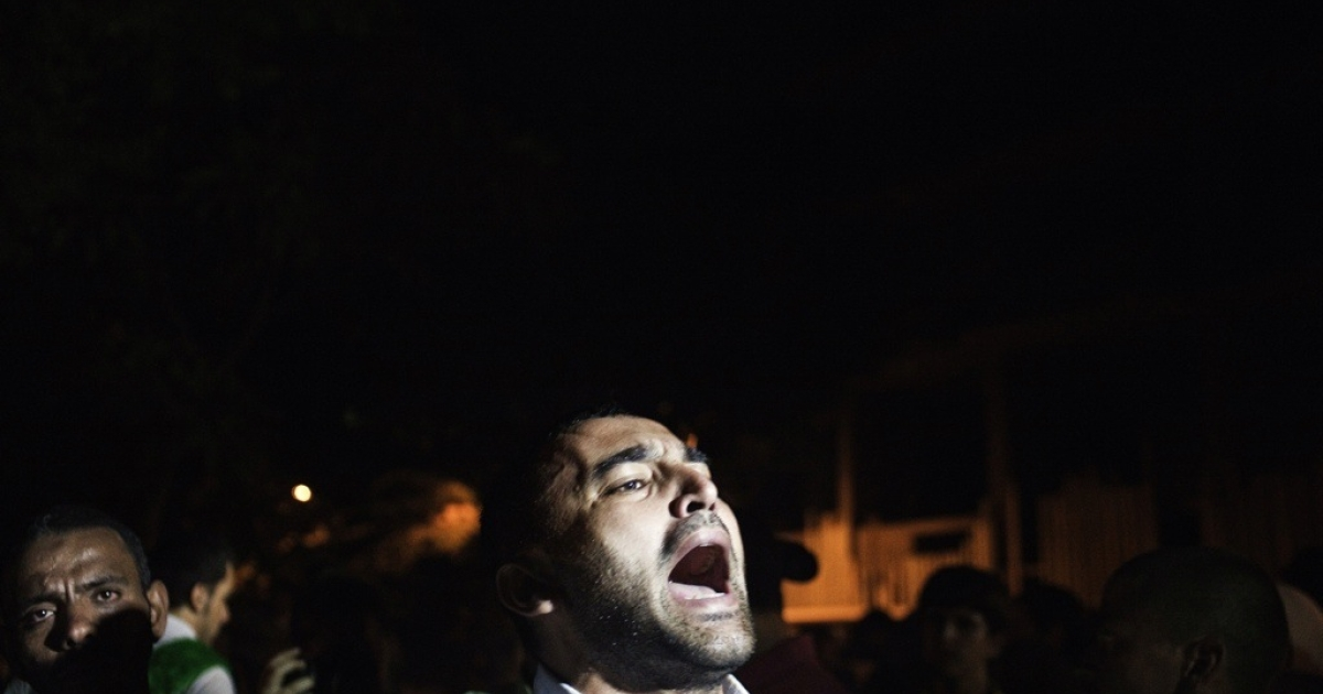 A protester shouts slogans against Syria's President Bashar al-Assad during a demonstration outside the Syrian embassy in Cairo on Sept. 4, 2012.</p>