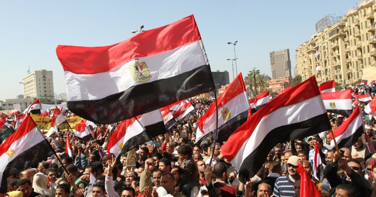 Thousands of Egyptians hold up their national flag as they gather following Friday prayers celebrating the end of former President Hosni Mubarak's regime and the success of their revolution in Cairo's Tahrir Square on March 4, 2011.</p>