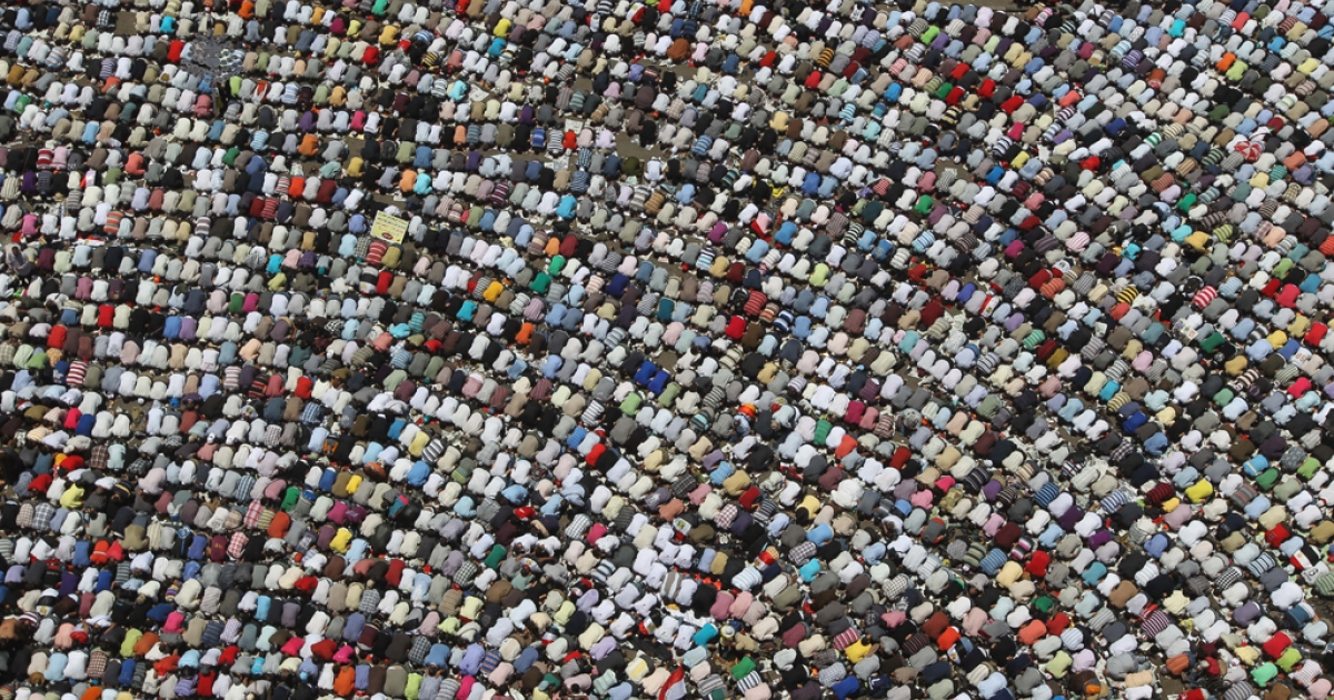 Egyptian demonstrators perform the weekly Friday prayer before a rally in downtown Cairo's Tahrir square on July 8, 2011.</p>