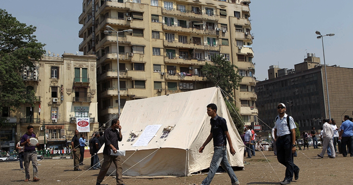 Egyptian pro-democracy activists set-up a tent at Cairo's landmark Tahrir Square on June 30, 2011 as they push for political reforms and to demand that officials found guilty of abuse be brought to justice, a day after violent clashes in the square which was the epicentre of protests that toppled president Hosni Mubarak.</p>