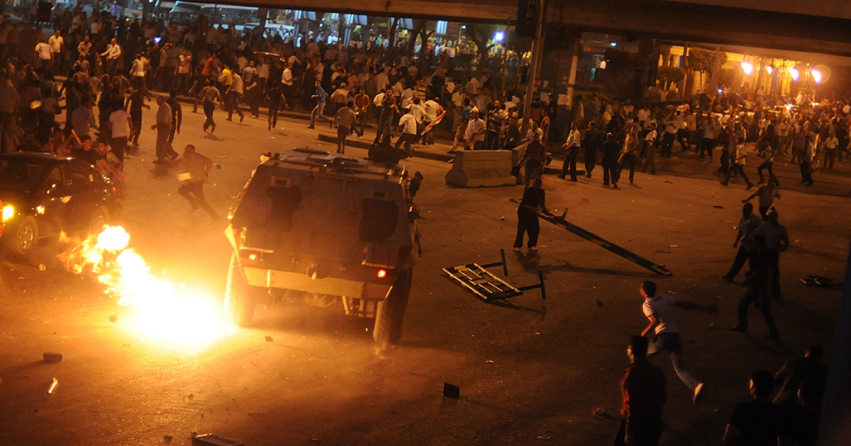 Egyptian Coptic Christians clash with soldiers and anti-riot police during a protest in Cairo against the burning of a church in southern Egypt in October 9, 2011.</p>