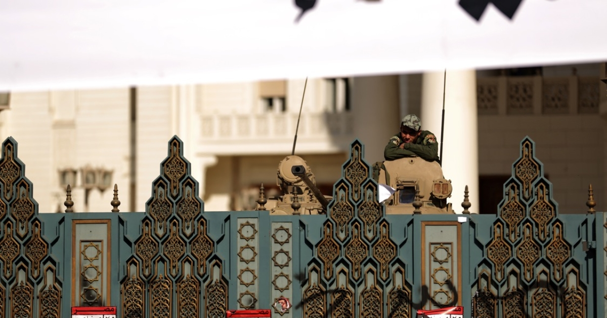 An Egyptian Republican Guard rests on his tank behind the gates of the presidential palace in Cairo on December 8, 2012. Egypt's military thrust itself into the political crisis by demanding dialogue and warning it would not permit events to take a 'disastrous' turn, amid protests against President Mohamed Morsi's expanded powers and efforts to push through a new constitution.</p>
