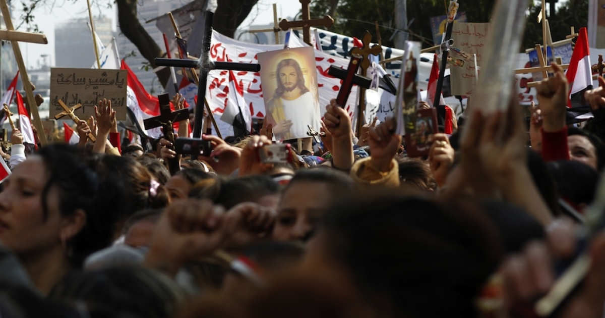 Egyptian Coptic Christians gather outside the state radio and television headquarters in Cairo on March 13, 2011, to demand the rebuilding of a church that was set ablaze, sparking deadly clashes between Muslims and Christians.</p>