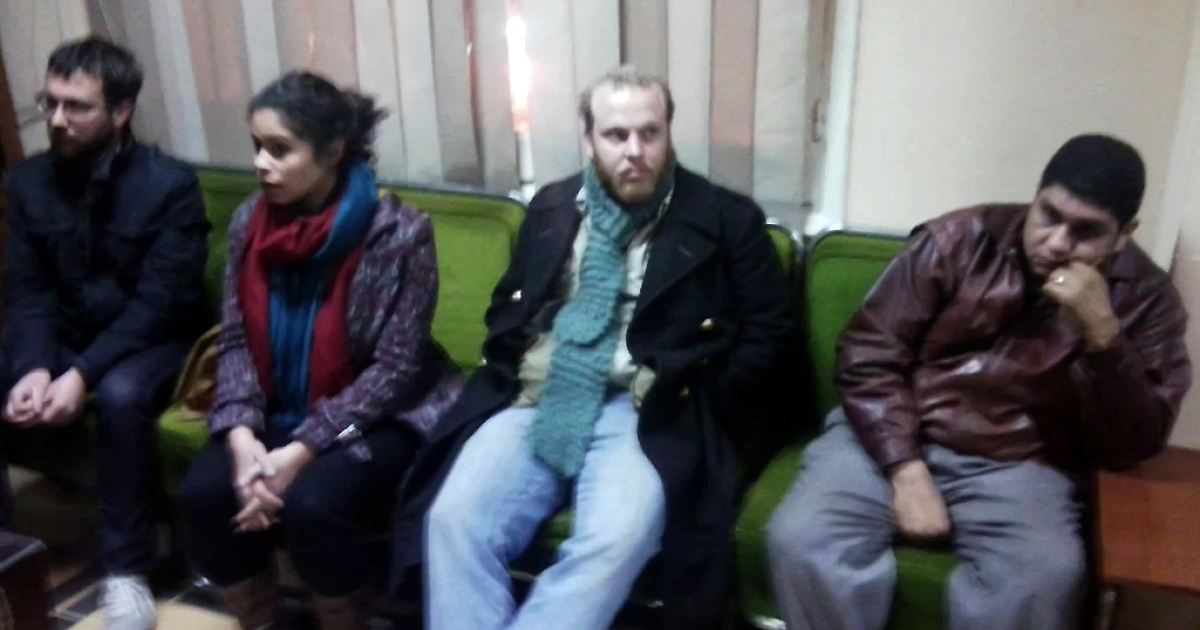 Freelance Australian reporter Austin Mackell, American student Derek Ludovici and translator Aliya Alwi are seen in this picture taken on Feb. 11, 2012, after being detained in the Nile Delta city of Mahalla on suspicion of paying Egyptians to stage protests against the authorities.</p>