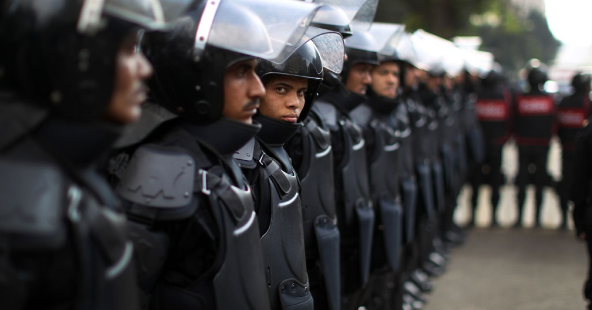 Egyptian riot police stand guard outside the upper house of parliament as President Mohamed Morsi gave a speech in Cairo on December 29, 2012. Morsi said in the address that a disputed new constitution guaranteed equality for all Egyptians and downplayed the country's economic woes.</p>