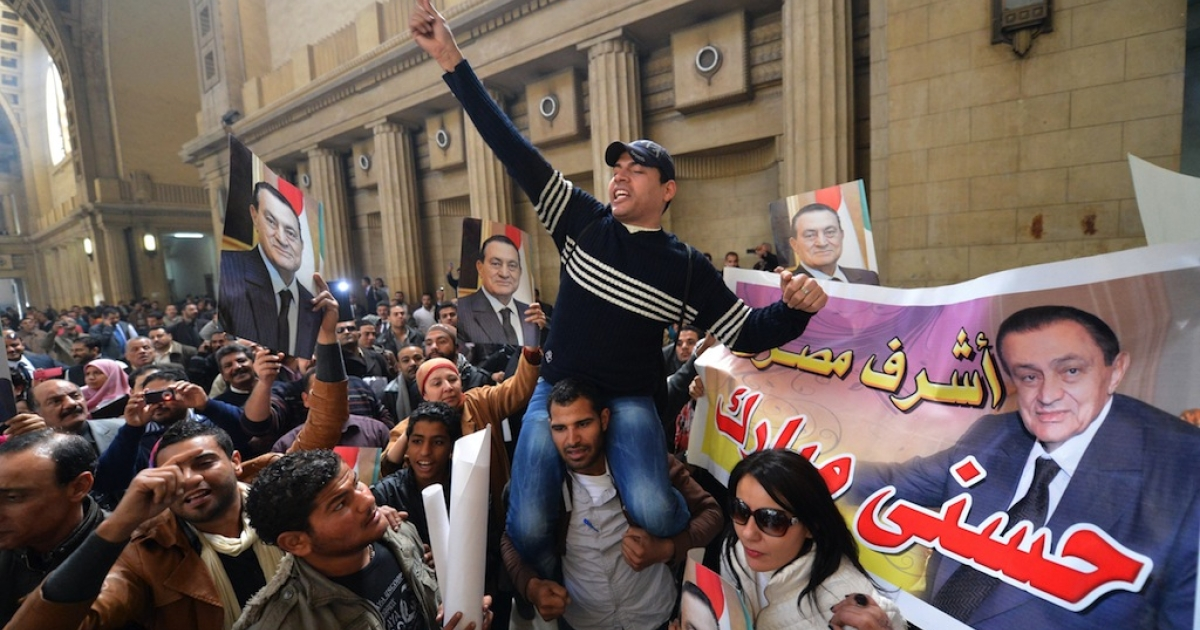 Supporters of ex-president Hosni Mubarak celebrate after the court of Cessation, Egypt's top appeals court, accepted an appeal for a retrial of the ousted president in Cairo on Jan. 13, 2013.</p>