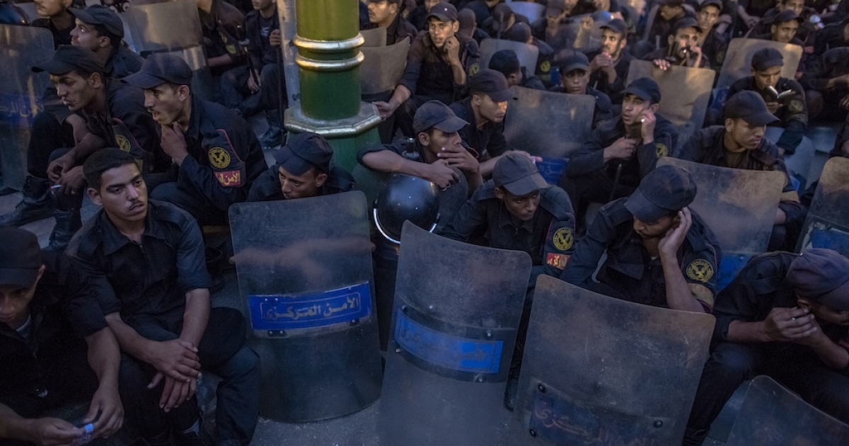 Egyptian riot police block the entrance to the parliament building, preventing members of the recently-scrapped legistlature from entering on June 19, 2012 in Cairo.</p>