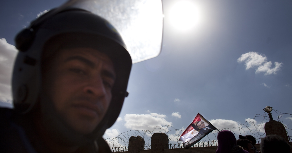 Supporters of the ousted Egyptian president Hosni Mubarak demonstrate outside the police academy, as Mubarak's trial continues on February 16, 2012 in Cairo, Egypt.</p>