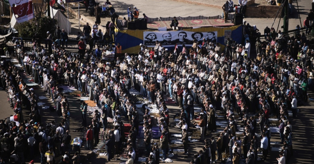 Egyptian protesters gather in Cairo's landmark Tahrir square during the Friday noon prayer on December 07, 2012, ahead of a demonstration against Egyptian President Mohamed Morsi. Egypt's mainly secular opposition rejected an offer of dialogue from Islamist President Morsi raising the prospect of further escalation of a crisis that already turned bloody earlier this week.</p>