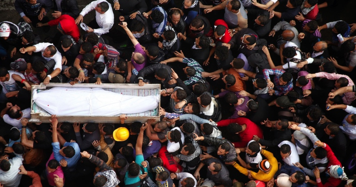 Egyptian Activists and April 6 movement members carry the coffin of Gaber Salah, an activist who died overnight after he was critically injured in clashes near Cairo's Tahrir Square last week, during his funeral at Tahrir square on November 26, 2012 in Cairo. Salah, a member of the April 6 movement known by his nickname