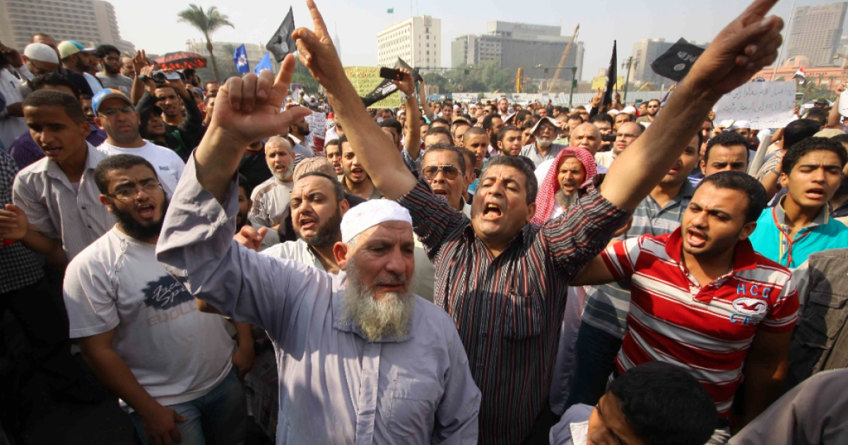 Egyptian Salafists shout slogans during a demonstration demanding the implementation of the sharia (Islamic law) in Cairo's Tahrir Square on November 2, 2012.</p>