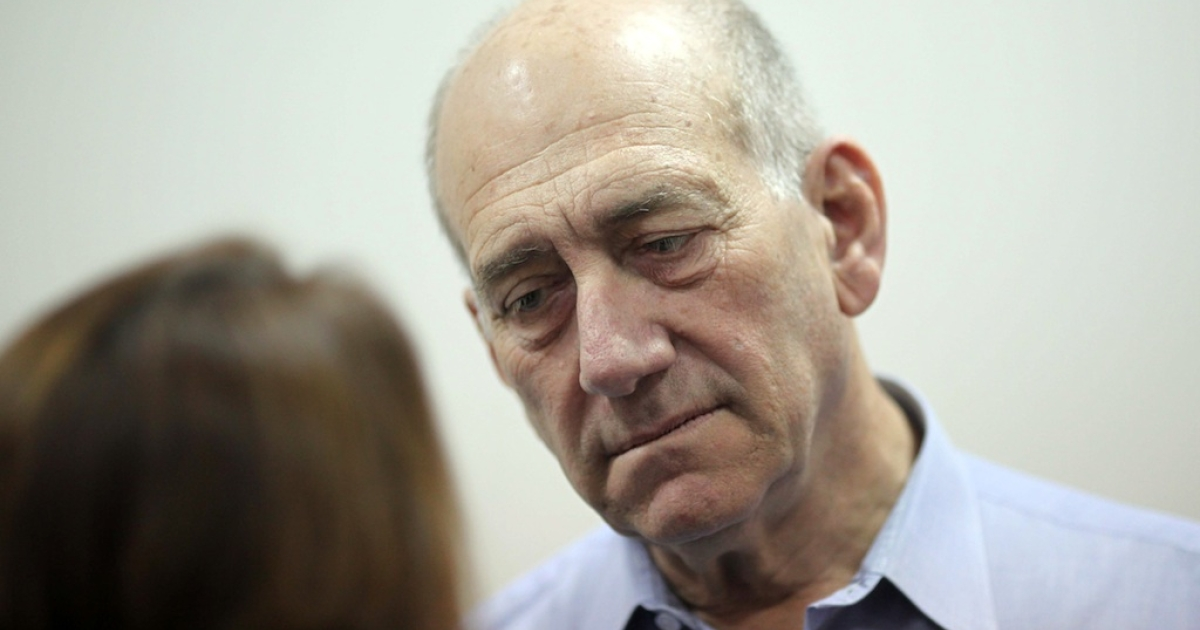 Former Prime Minister Ehud Olmert arrives at the Jerusalem District Court  in May last year at the start of a previous corruption trial.</p>