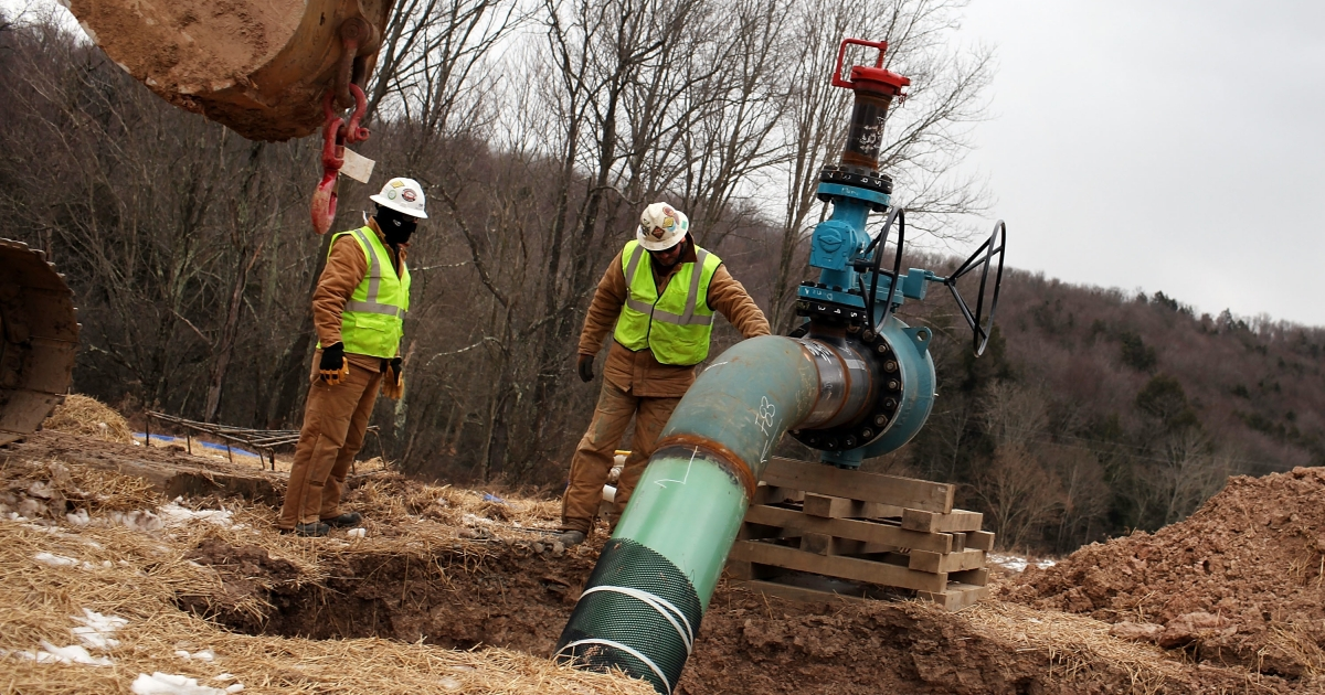 Men with Cabot Oil and Gas work on a natural gas valve at a hydraulic fracturing site in South Montrose, Pa., on Jan. 18, 2012.</p>