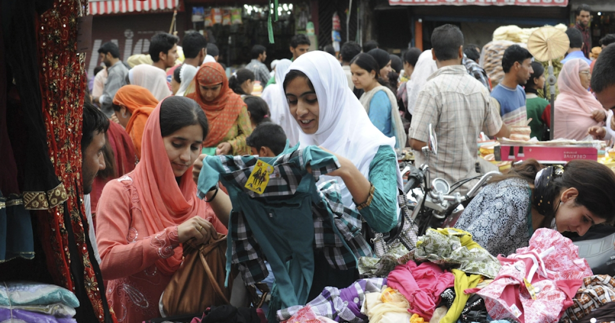 Kashmiri Muslims shop at the central market ahead of Eid-ul-Fitr in Srinagar on August 28, 2011. Markets across the Muslim world witnessed a huge shopping rush during Eid-ul-Fitr which marks the end of Ramadan.The celebrations depend on the appearance of the crescent moon as the Muslim calender is lunar.</p>