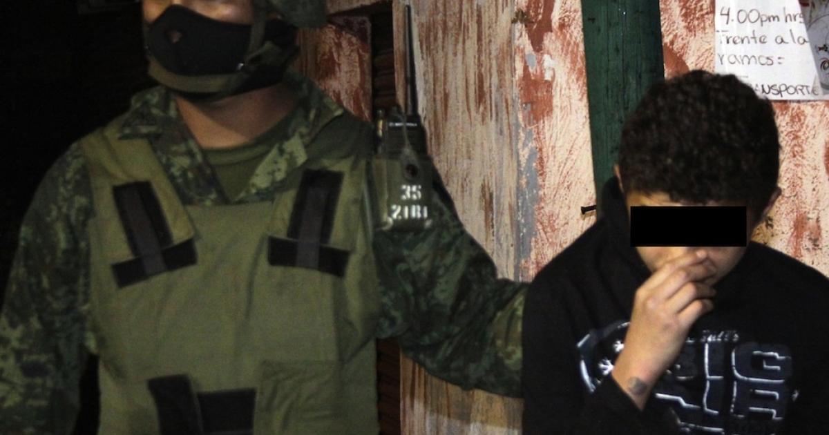 A Mexican soldier escorts Edgar Jimenez Lugo, known as