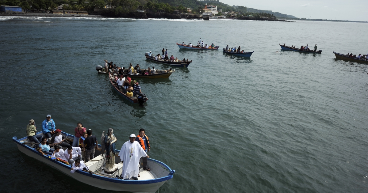 Out to sea: Fishermen set off Oct. 23 from El Salvador's port of La Libertad in a holy procession in celebration of their patron saint.</p>