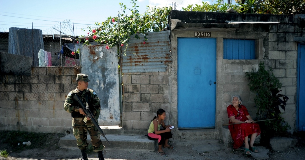 A Salvadoran soldier stands guard in a San Salvador slum where gang violence had been escalating. A truce between the country's chief rival gangs is expected to stem the violence but many Salvadorans are skeptical it will hold.</p>