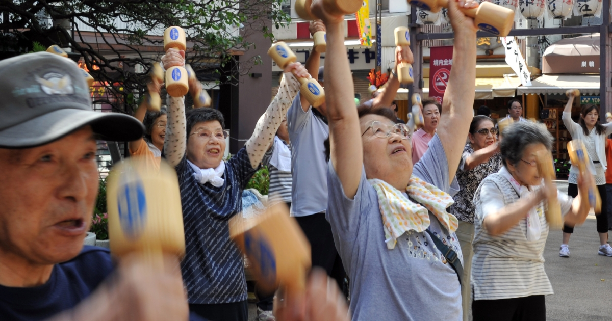 Elderly people work out with wooden dumb-bells in the grounds of a temple in Tokyo on September 17, 2012 to celebrate Japan's Respect-for-the-Aged-Day.</p>