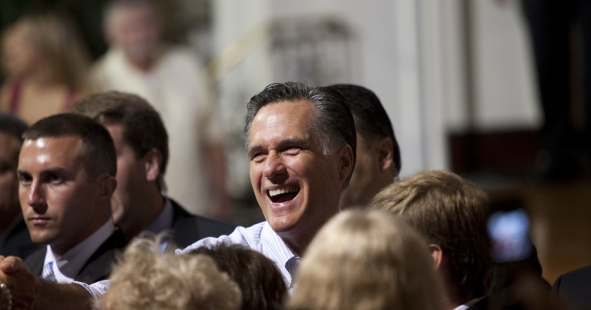 Presumptive Republican presidential nominee and former Massachusetts Gov. Mitt Romney greets the crowd during a campaign stop on May 16, 2012 in St. Petersburg, Florida.</p>