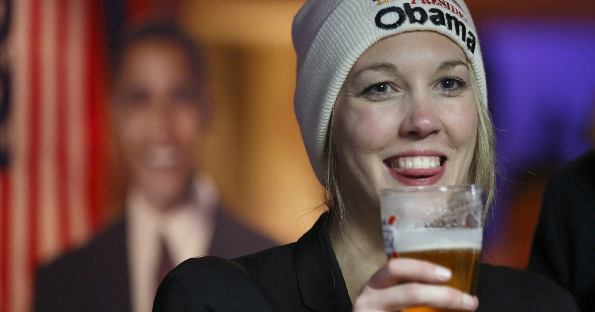 An Obama supporter celebrates in London.</p>