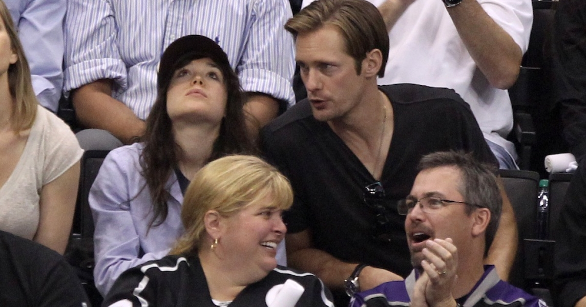 Actors Ellen Page and Alexander Skarsgard watch Game Four of the 2012 Stanley Cup Final between the Los Angeles Kings and the New Jersey Devils at Staples Center on June 6, 2012 in Los Angeles, California.</p>