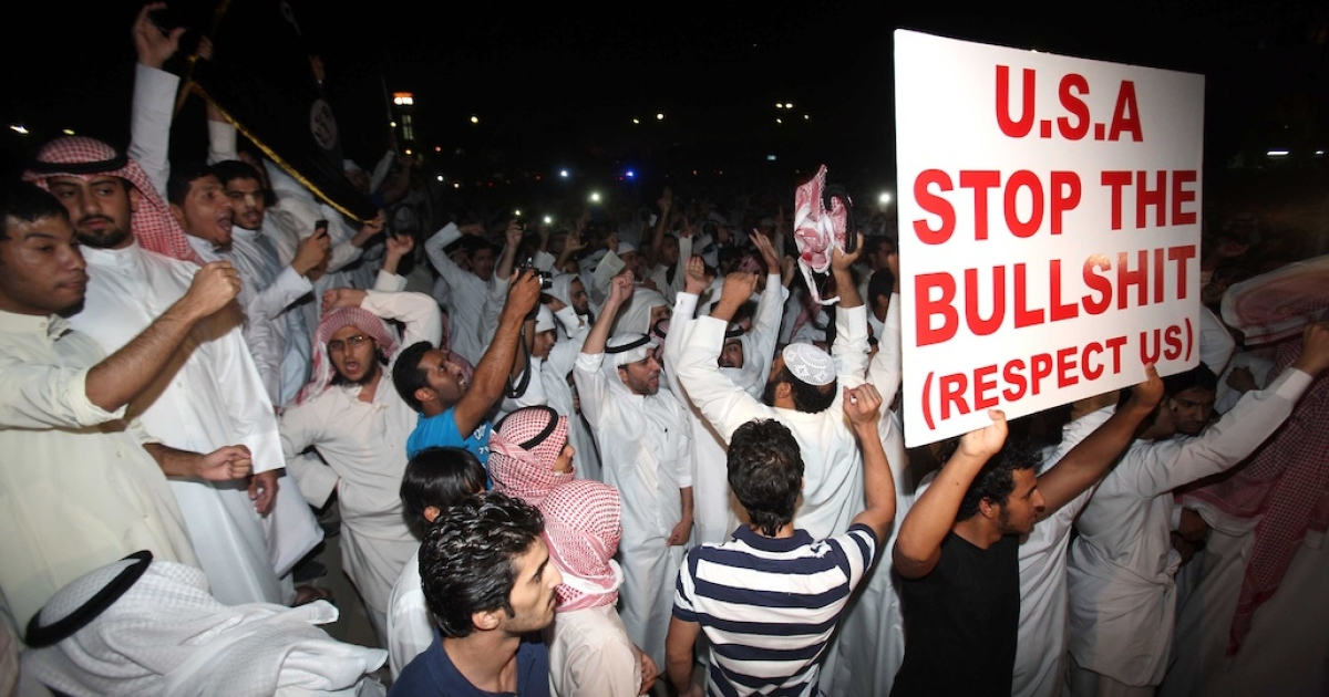 Kuwaitis protest against a film deemed offensive to Islam near the US Embassy in Kuwait City on Sept. 13, 2012. Protests have erupted since Sept. 11 outside US diplomatic missions in several Arab and Muslim states by demonstrators who deem the low-budget movie 'Innocence of Muslims,' made in the United States, offensive to Islam.</p>