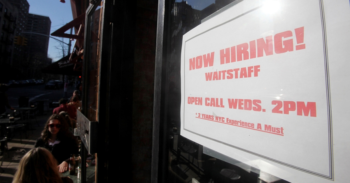 A 'now hiring' sign is seen in the window of a restaurant in New York City. United States job openings increased in February, as did economic optimism.</p>