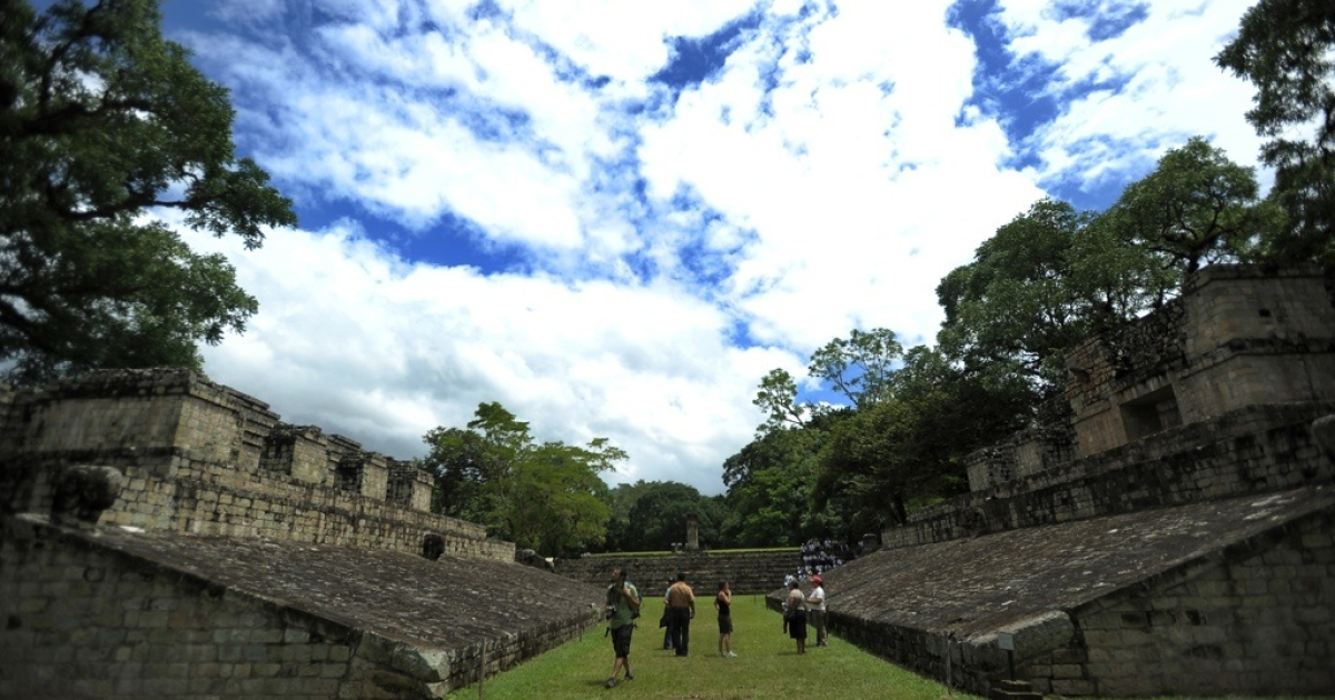 Tourists are seen at the Copan ruins. Doomsday tourists are expected to flock to Copan, an ancient Mayan ruin, before Dec. 21, 2012, which some believe the Mayans predicted to be the end of the world.</p>