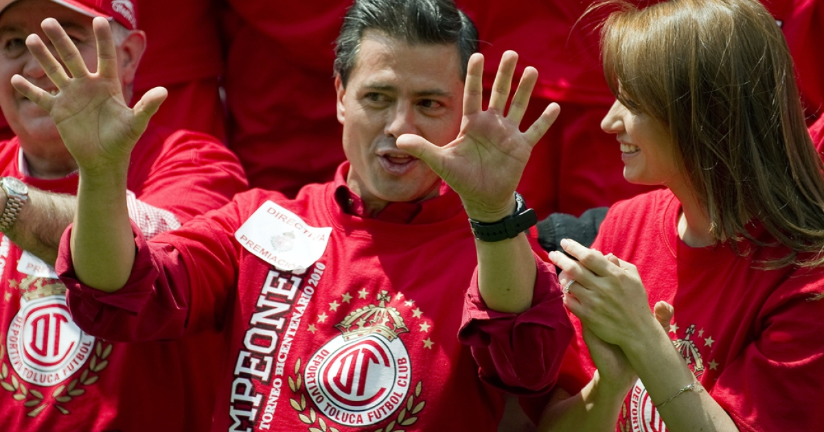 Enrique Pena Nieto and Angelica Rivera celebrate at a soccer match in Toluca, Mexico, on May 23, 2010.</p>