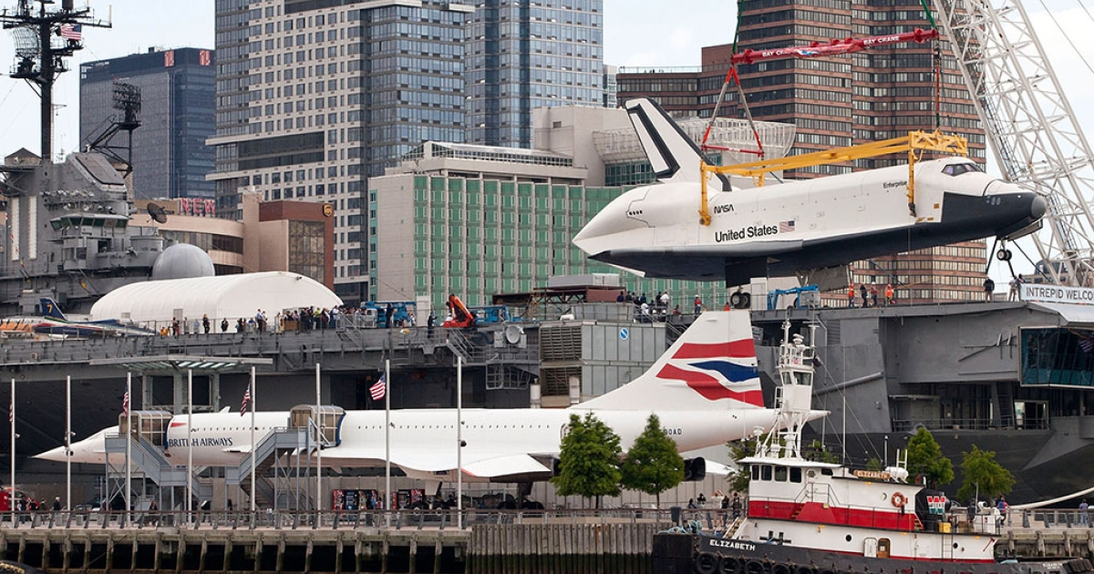 The space shuttle Enterprise is lifted by a crane on to the USS Intrepid on June 6, 2012 in New York City. Upon the Intrepid, the space shuttle will be on display for viewing by the general public. The British Airways Concorde is seen in the foreground.</p>