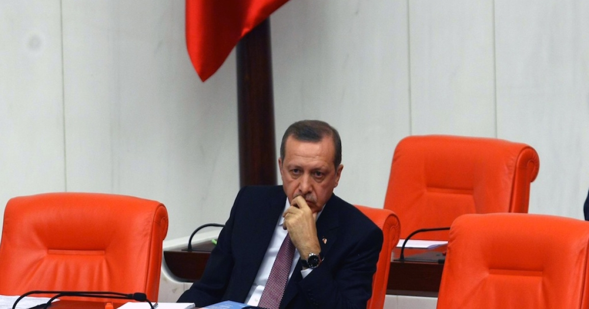 Turkish Prime Minister Recep Tayyip Erdogan sits in Parliament on December 10, 2012. Erdogan has been behind many repressive new laws that human rights groups say violate political freedoms.</p>