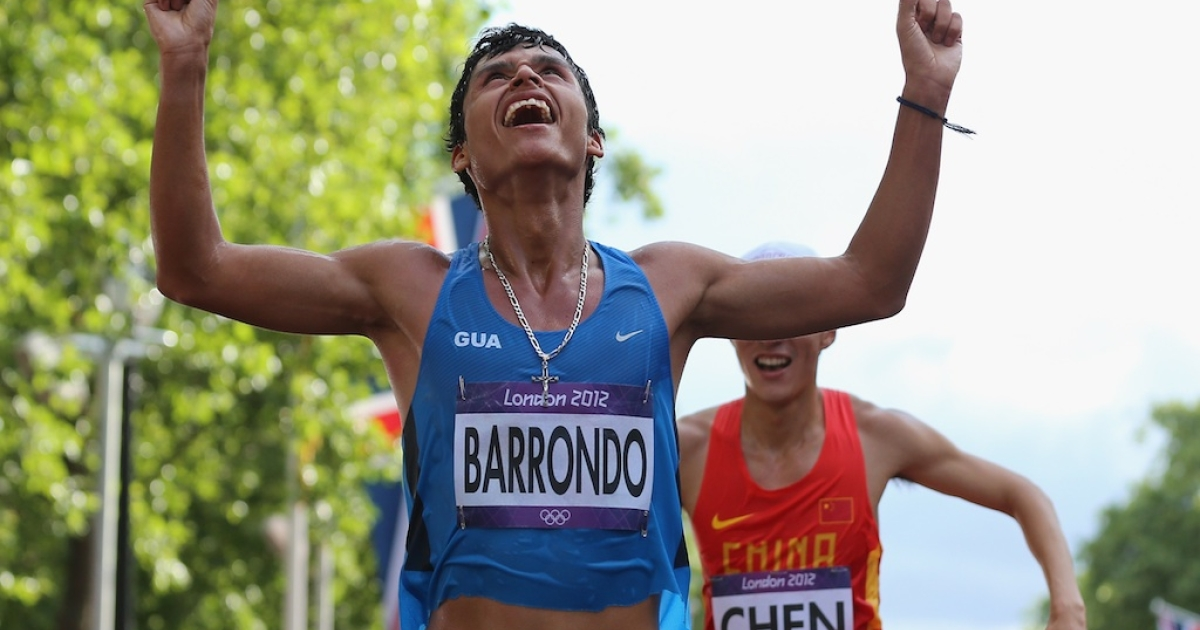 Guatemala's Erick Barrondo crosses the 20-km race walk finish line to win silver, the Central American country's first-ever Olympic medal, on Day 8 of the London 2012 Olympic Games.</p>