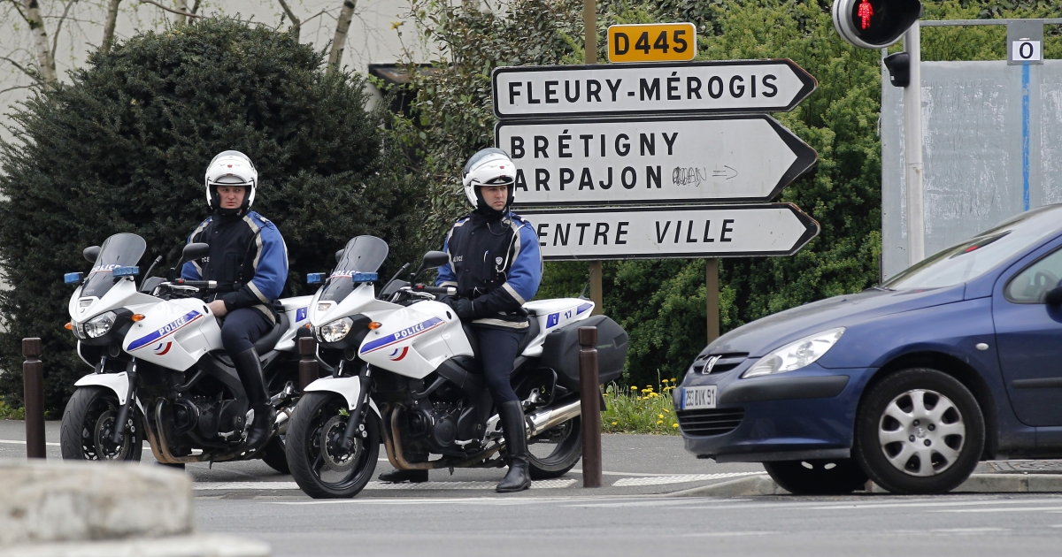 French motorcycle police officers survey traffic on April 7, 2012 in Viry-Chatillon, south of Paris.</p>