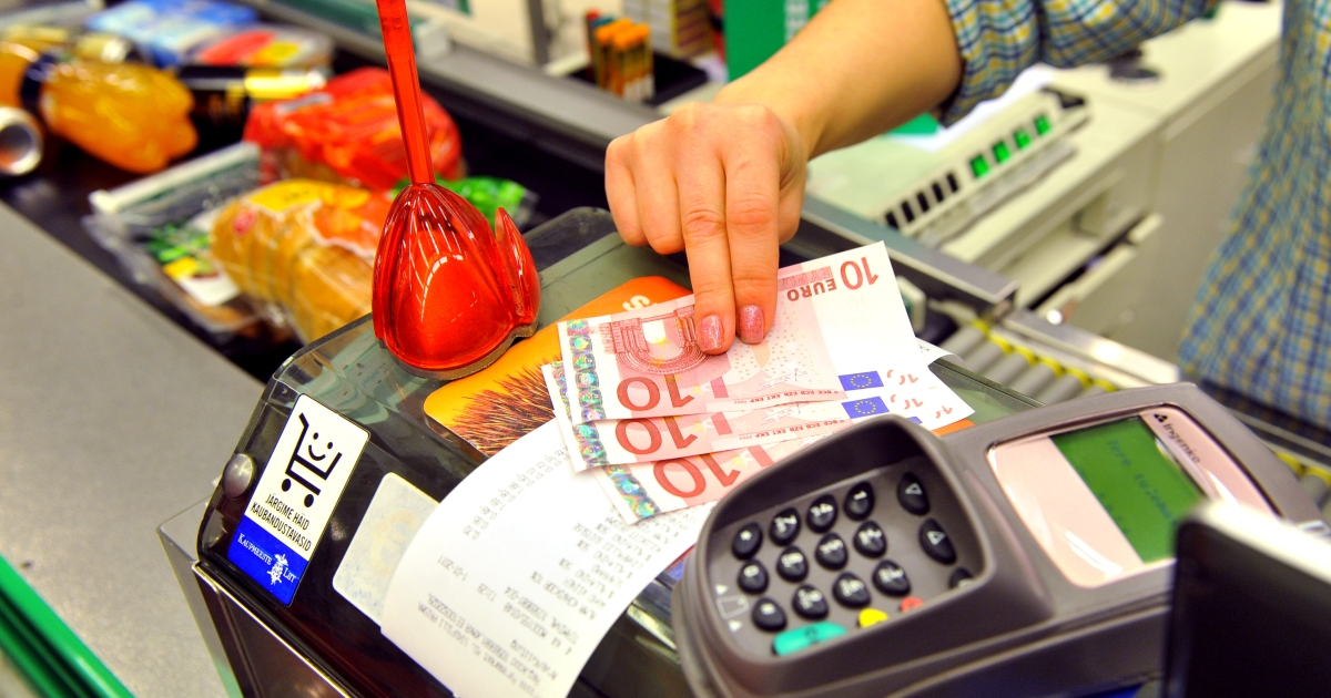 A Estonian woman gives change to a customer in Euro in a supermarket in Tallinn on January 1, 2011. Estonia has become an oasis in the euro zone and is now the only euro zone country running a budget surplus.</p>