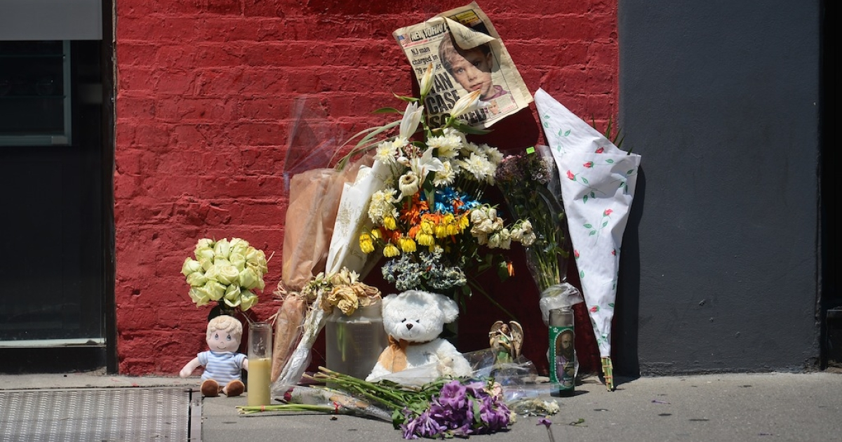A street shrine to six-year-old Etan Patz, who disappeared 33 years ago, is set in front of the building where suspect Pedro Hernandez confessed to have strangled the boy in New York on May 29, 2012. Hernandez, 51, told police he strangled the boy after luring him 'with the promise of a soda' to the basement of the grocery store where he worked, close to a school bus stop where the child was last seen in 1979.</p>