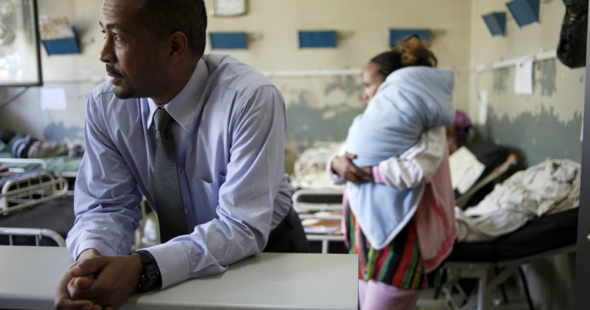 Solomon Zewdu M.D., the country director of Ethiopia for Johns Hopkins Bloomberg School of Public Health, listens to a nurse in the children's ward at Black Lion Hospital in Addis Ababa, Ethiopia on April 5, 2011.</p>