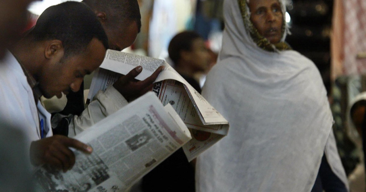 Men read newspapers in the old Mercato (market) in Addis Ababa, Ethiopia.</p>