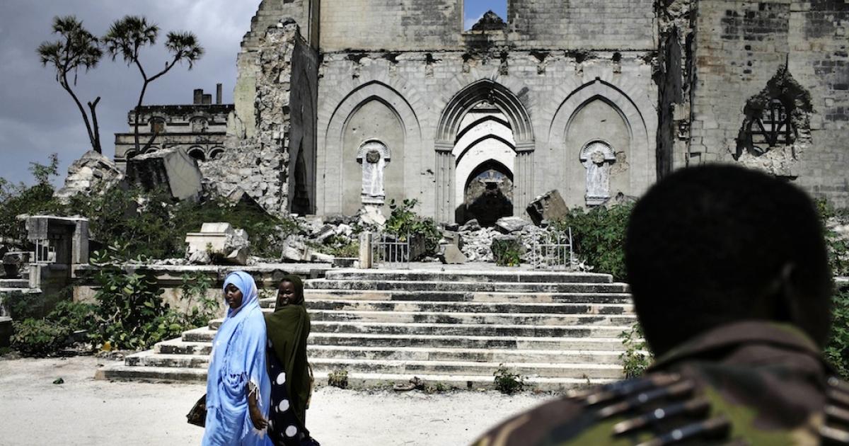 Somali women walk in front of an Ethiopian soldier in Mogadishu on Dec. 8, 2007.</p>