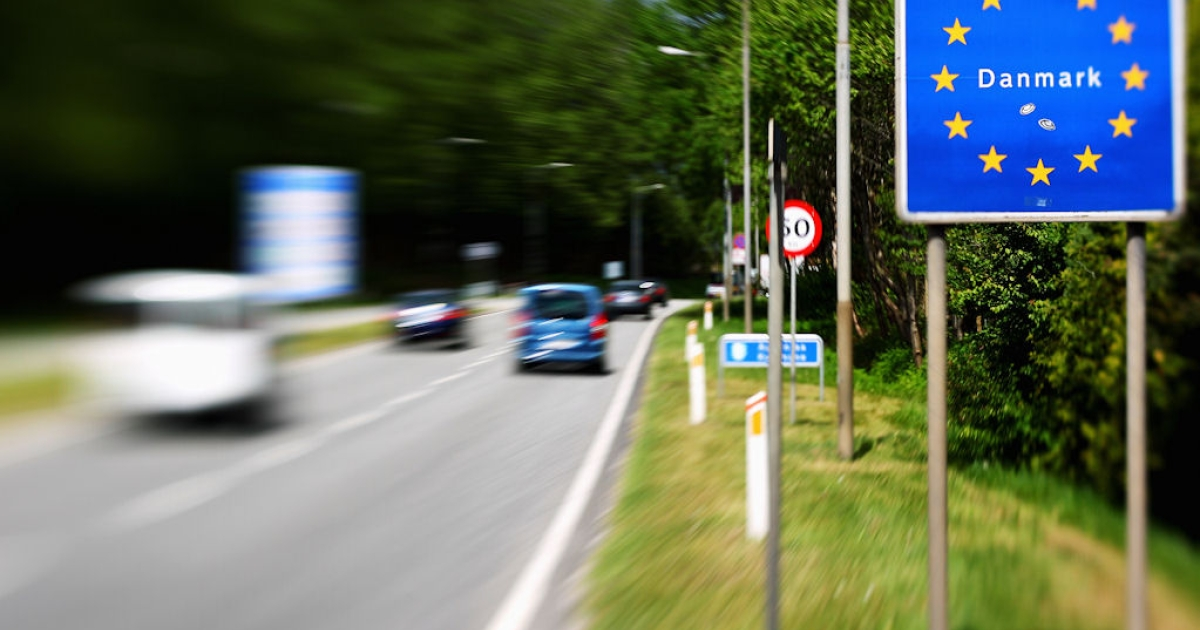 Cars pass the German-Danish border on May 13, 2011 near Flensburg, Germany. Both Germany and Denmark are part of the Schengen zone, where countries have pledged to allow people and goods to move freely.</p>