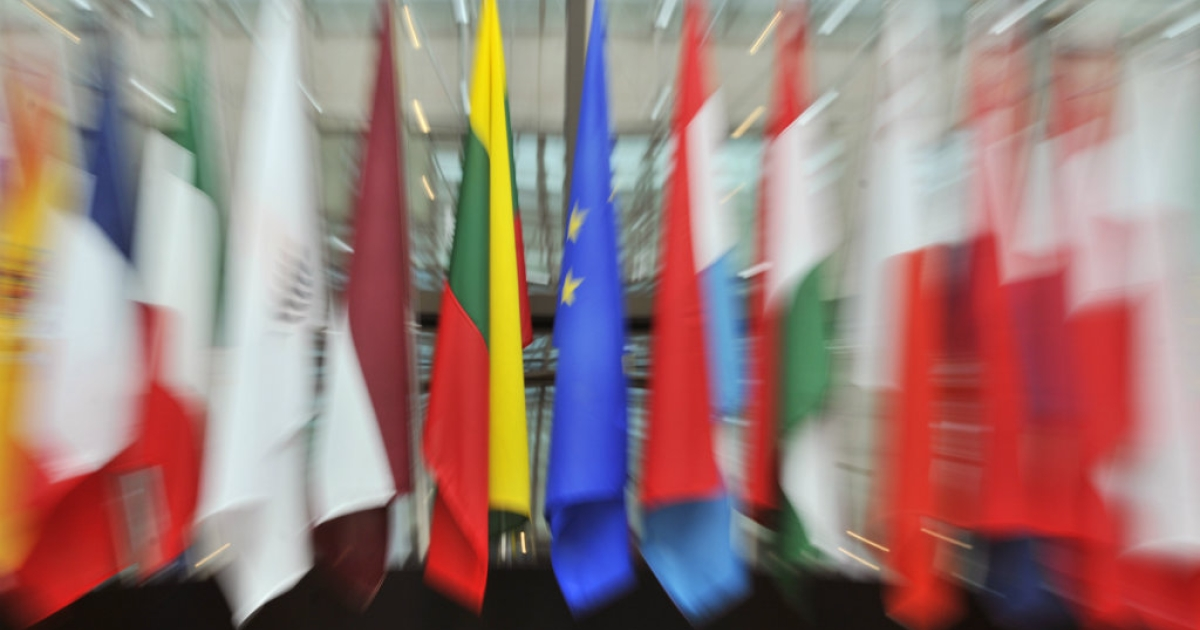 The EU flags on display in the great hall of the European Union Council in Brussels.</p>