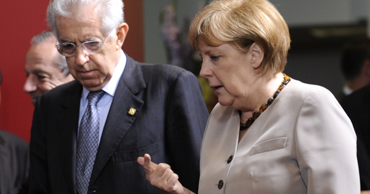 German Chancellor Angela Merkel talks with Italian Prime Minister Mario Monti after a meeting of European Union leaders in Brussels on June 28. EU leaders debate 'a big leap forward' to strengthen their union and save the euro at a two-day summit starting Thursday.</p>