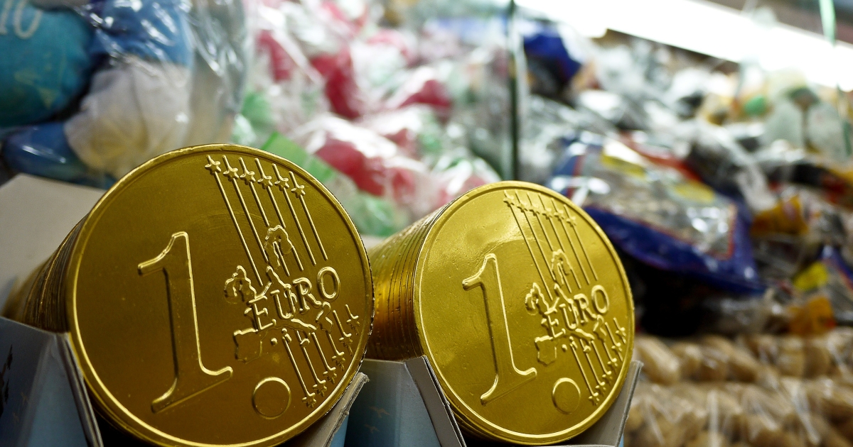 Chocolate euro coins are displayed on a stand at Piazza Navona in central Rome, on Dec. 30, 2011.</p>