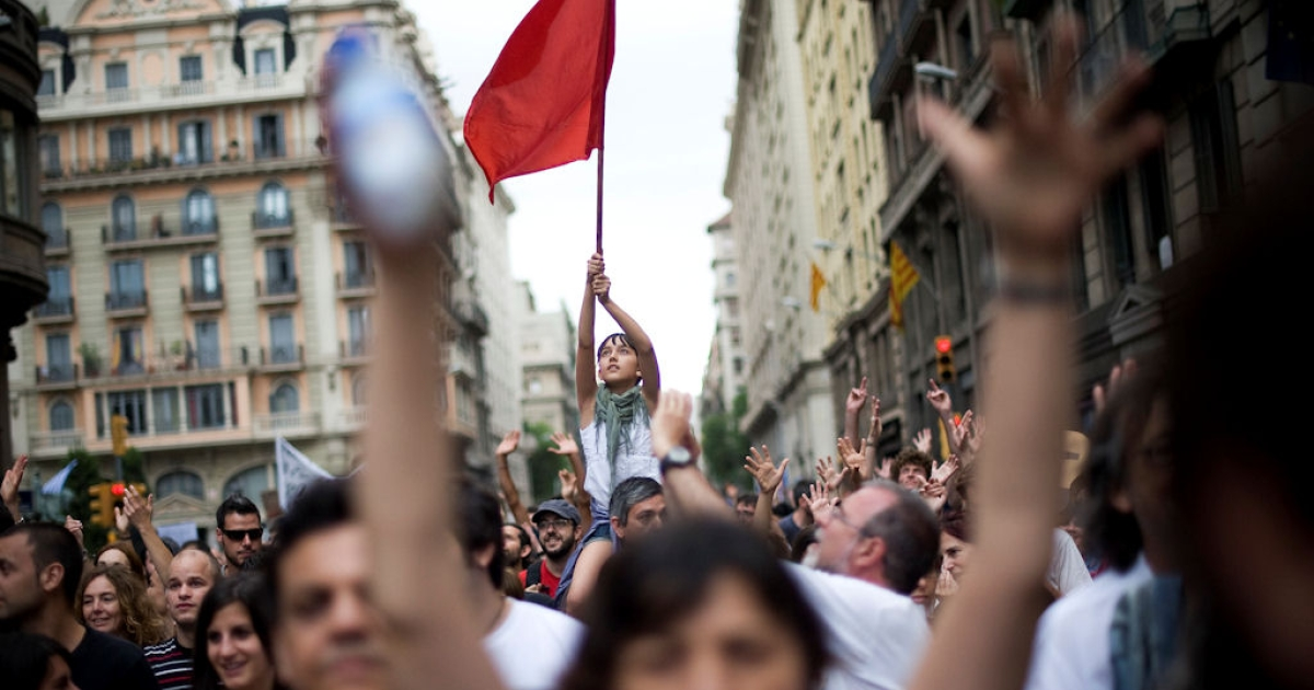 Demonstrators shout slogans during a protest against the euro zone leaders' agreed 'Pact For The Euro' on June 19, 2011 in Barcelona, Spain. Thousands across Spain protested how the country's economic crisis is being handled.</p>