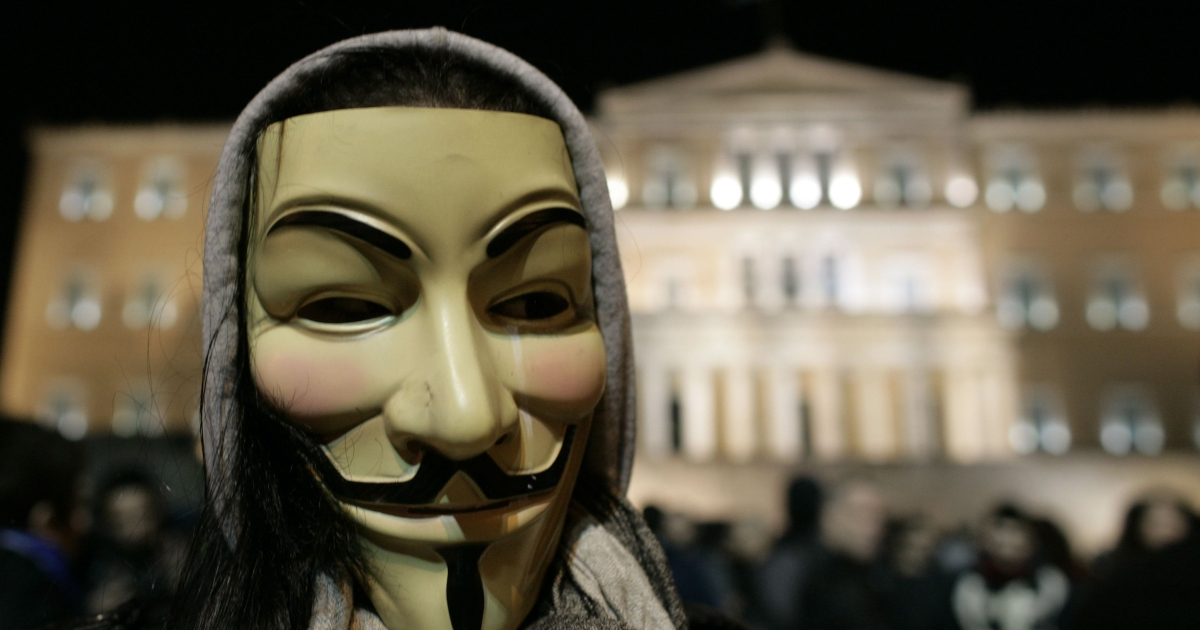 A demonstrator wears an 'anonymous mask' during a protest against austerity measures in front of the Greek Parliament in Athens on February 19. A fifth year of recession is expected to pull the struggling nation's output down 4.4 percent in 2012.</p>