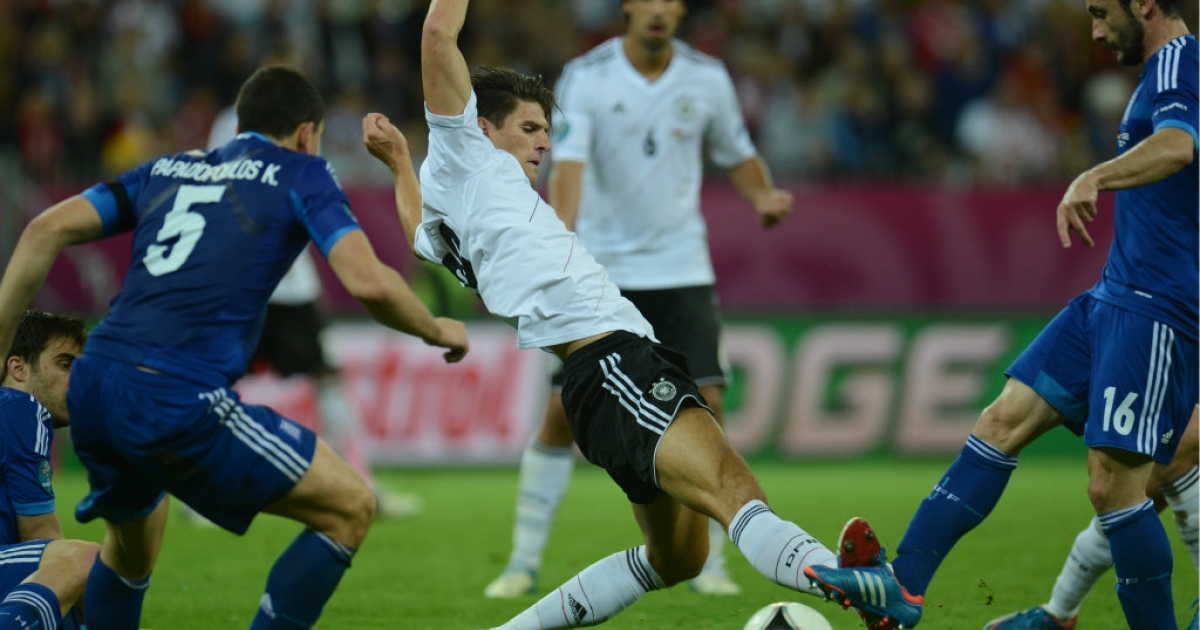 German forward Mario Gomez (C) vies with Greek midfielder Giorgos Fotakis (R) during the Euro 2012 football championships quarter-final match. On Thursday, Germany faces their biggest rival yet: Italy.</p>