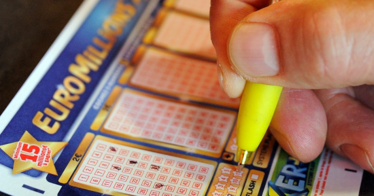 A person fills in a EuroMillions lottery grid on August 7, 2012, in the northern city of Lille.</p>