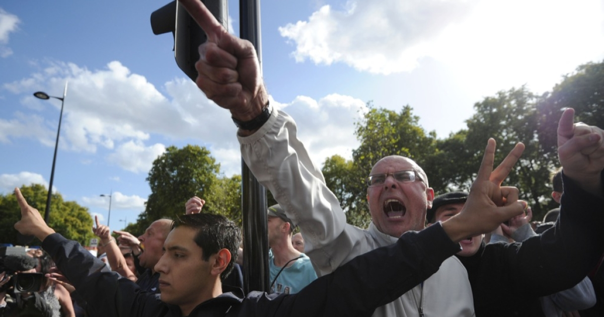 Members of the right-wing English Defence League (EDL) shout at Islamist demonstrators protesting outside the US embassy in London on Sept. 11, 2011 during a ceremony to mark the 10th anniversary of the 9/11 attacks on the United States. Around 50 people brandished anti-US banners, chanted slogans and burnt a small piece of paper with a picture of the US flag on it.</p>