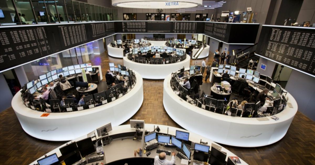 Stock traders work at the Deutsche Boerse in the central German city of Frankfurt am Main after a press conference today. The EU Commission vetoed a transatlantic tie-up of the Frankfurt and New York stock exchanges, a decision slammed here as 'out of touch with reality' and marking a 'dark day' for Europe.</p>