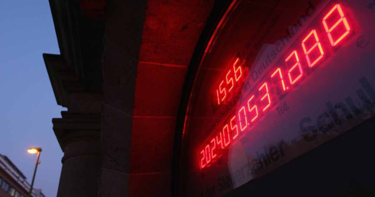 A 'debt meter,' ostensibly showing the current level of the German national debt, reads over EUR 2 trillion over the entrance to the Federation Of Tax Payers on November 21, 2011 in Berlin, Germany. According to the meter Germany's debt level is rising at a rate of EUR 1,556 per second.</p>